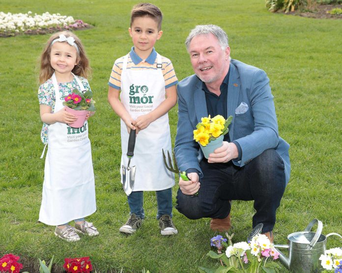 Amy Dempsey aged 4 and Gianluca Bux aged 5 with Super Garden judge and the face of Bloom Festival, Gary Graham as they celebrated the arrival of summer and GroMór 2019 - encouraging everyone to visit their local garden centres and nurseries, buy Irish plants and get growing! Pic Brian McEvoy
